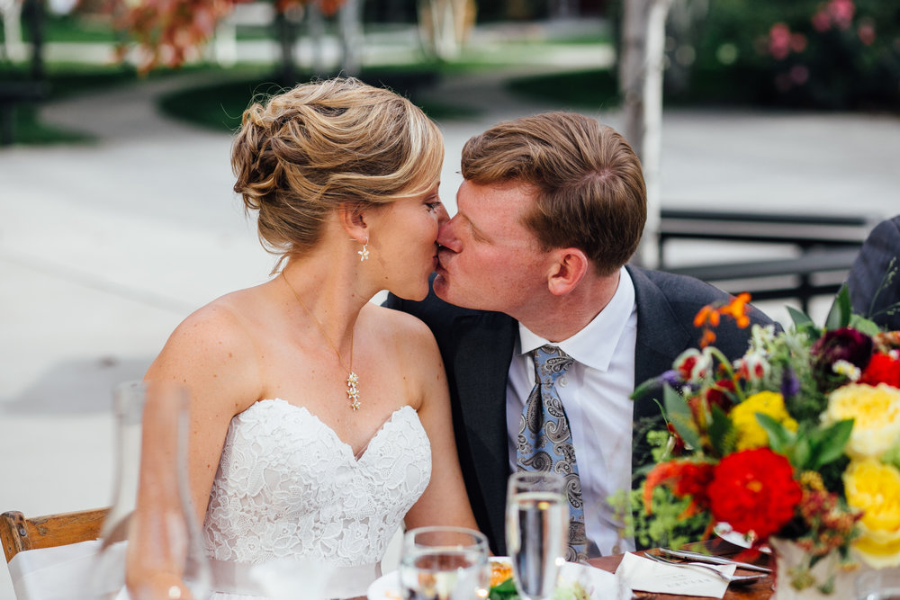 Bride and Groom Kiss Reception Brookside Gardens Berthoud Colorado Wedding
