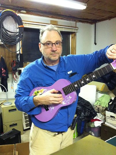 Tim tuning donated guitars for the Ecumenical Storehouse 2014.