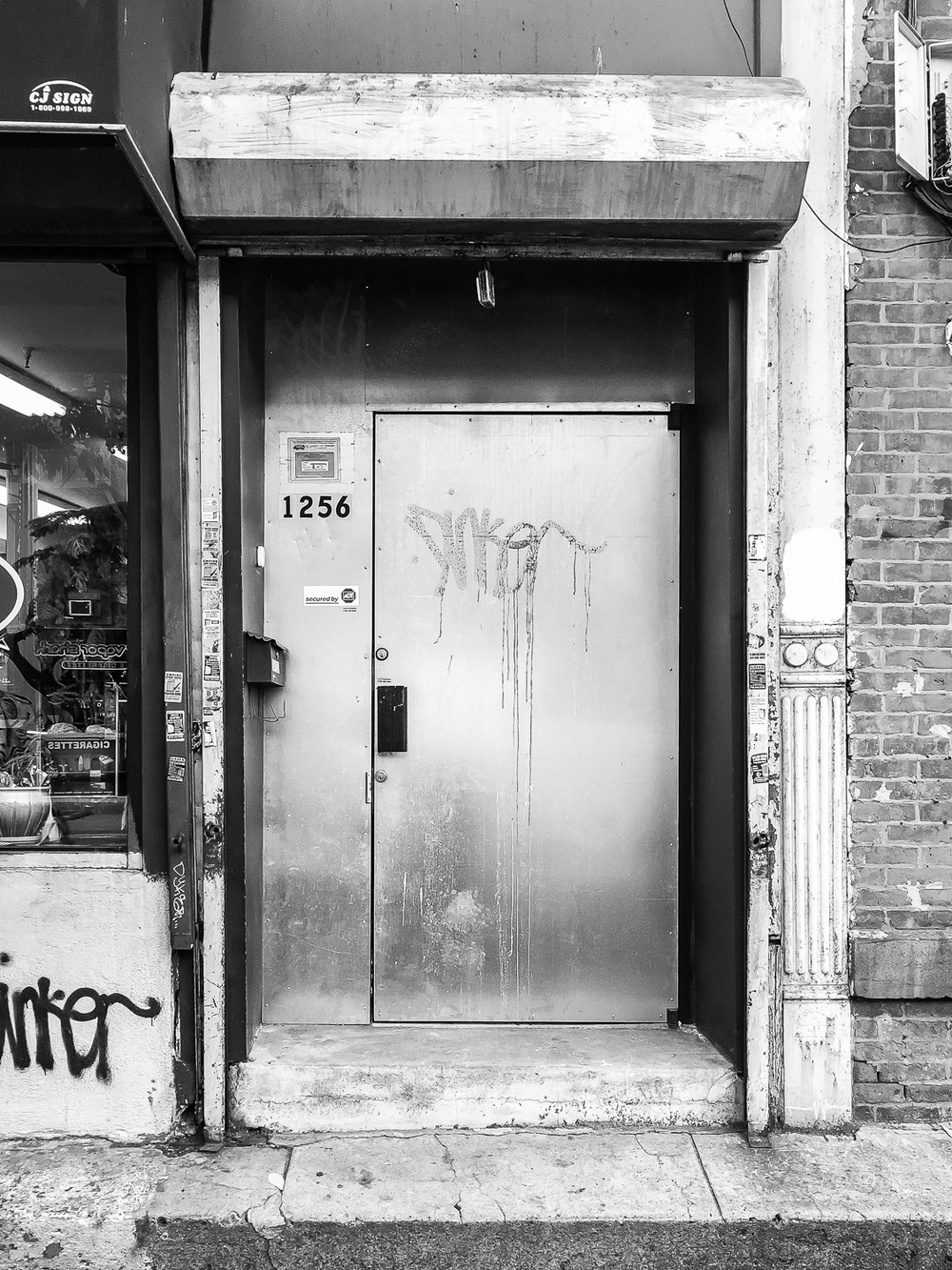 Graffiti Door to Andy Cross Art Studio Building in Bed Stuy Brooklyn NYC