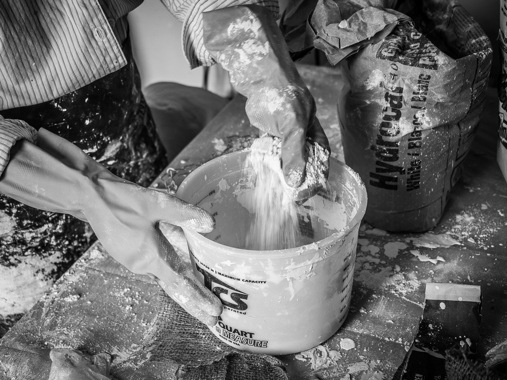 Stacy Fisher Gloved Hands Mixing Sculpture Materials in the Art Studio Brooklyn Neesh NYC