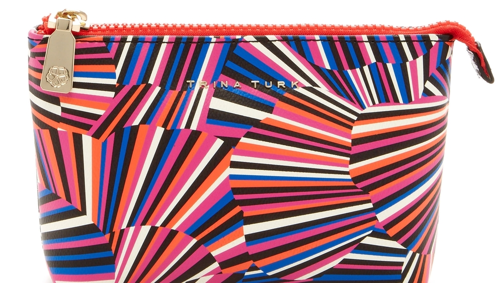 Trina Turk, how I love you. This bag will brighten the mood of your favorite on-the-go cosmetics lover, and everyone around her.Mine pops out inside my dark purse and on the bathroom counter, reminding me of one of my happiest places, Palm Springs. $48.