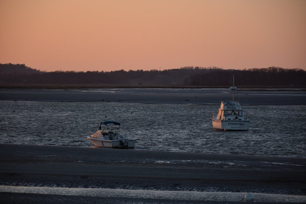 Fishing boats on the Essex River are the only lonely boats in the harbor.