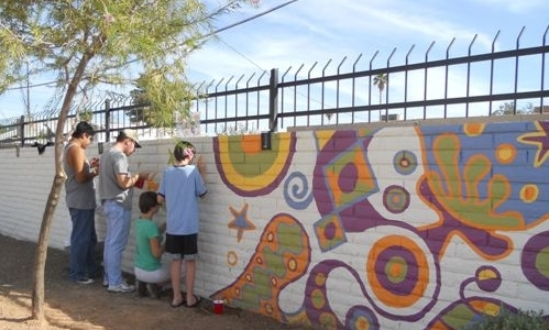 SARRC'S VOCATIONAL & LIFE SKILLS ACADEMY                                                    300-FOOT MURAL DESIGNED AND PAINTEDBY AUTISM ARTISANS AND LISA MACCOLLUM