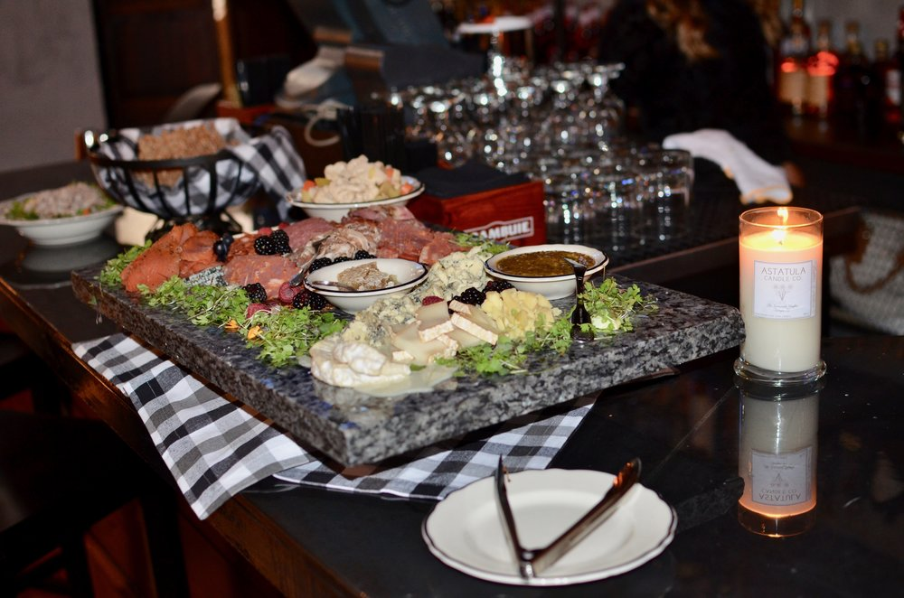 charcuterie board with a chef's selection of house cured meats and cheeses