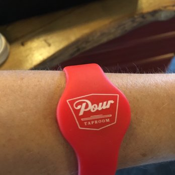 Pour Taproom wristband that tracks your consumption