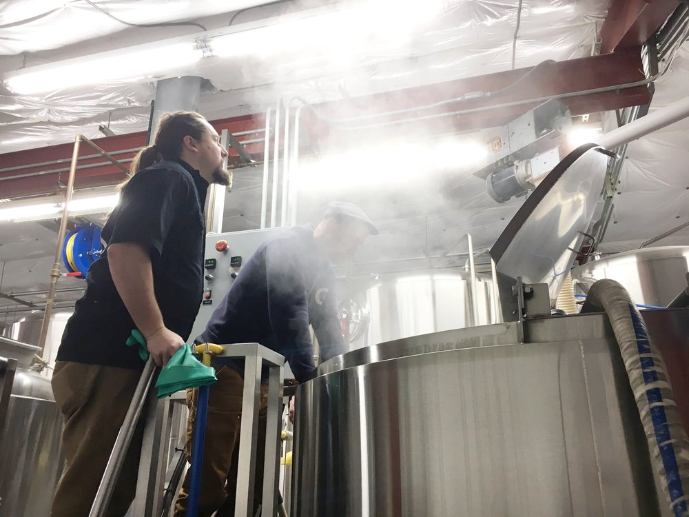 Uptown's Tyler Staples brewing the oyster stout with Gigantic Brewmaster Van Havig.