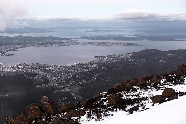 This is where I live!  Hobart in Tasmania, Australia. I moved to Tasmania with my wife a few months back. Took a sabbatical from social media; now that I'm settled both in this new wonderland and in my married life, I'm back.  This image was taken from Mount Wellington which sits aside Hobart city and is cold, snowy and windy in winters but offers some breathtaking views of the city and it's surrounding landscape.  #thisiswhereilive #traveldeeper #justgoshoot #hobart #tasmania #australia #tassiestyle #mountwellington