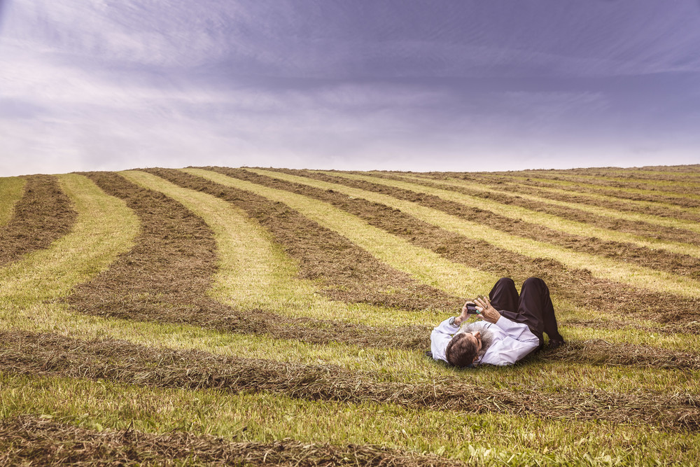 Man laying in a field