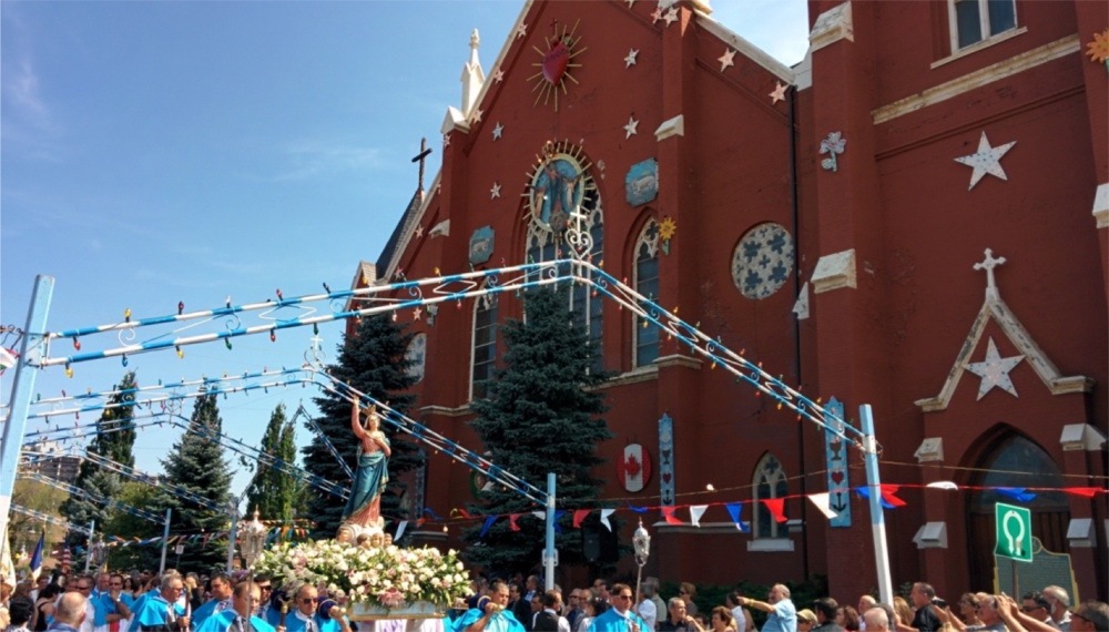 The church in our neighbourhood has a parade for Mary and it's pretty intense and awesome and odd.
