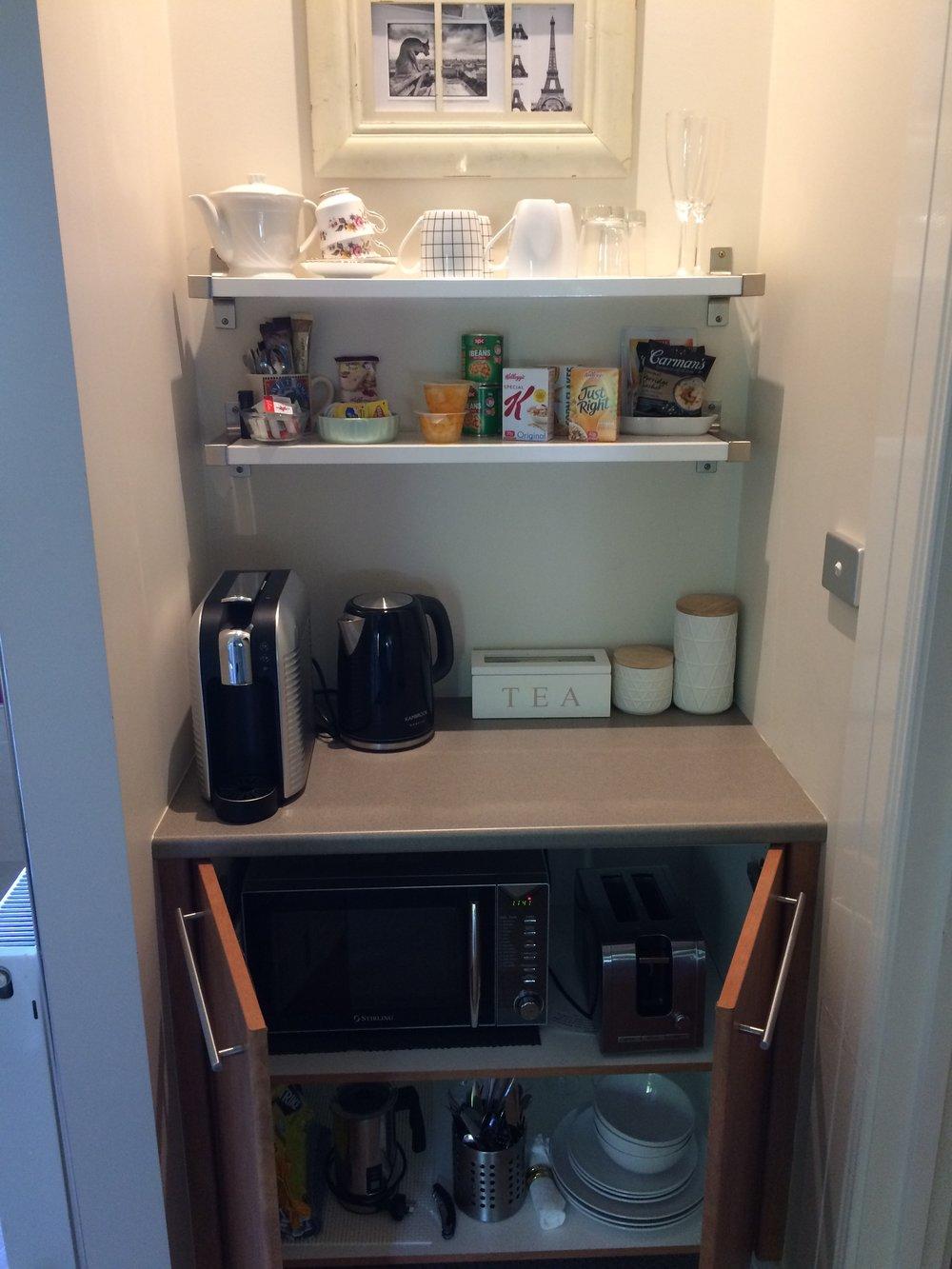 Kitchenette cupboard open.JPG