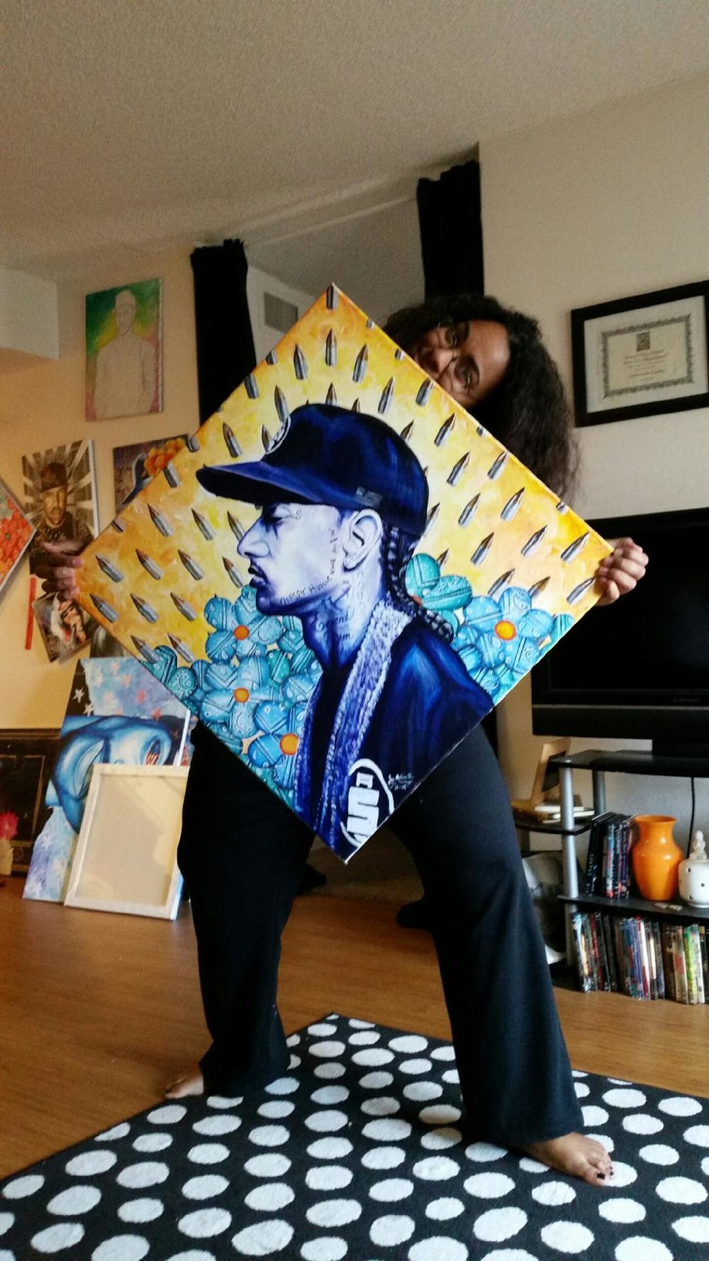 "Antoinette holding her painting ""Sleepless Nights"" after it had been autographed."