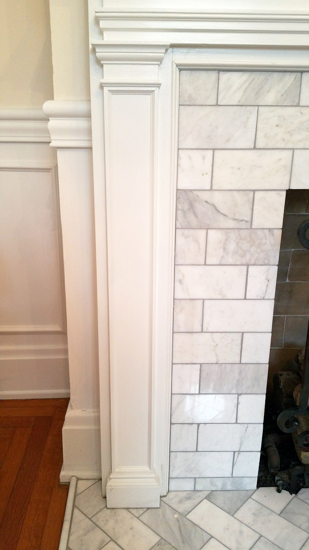 Living Room Fireplace Detail  Carrera Marble  (Facing Tiles in Subway Layout Hearth Tiles in Herringbone Pattern)
