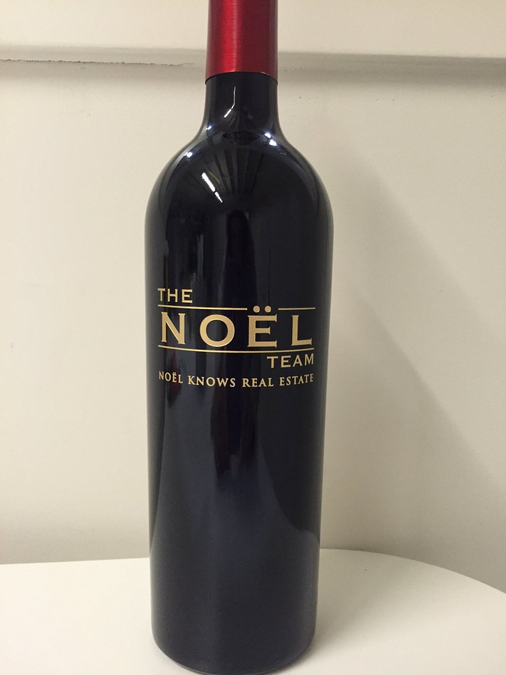Etched Bottle_Noel_Real Estate_Realtor.jpg
