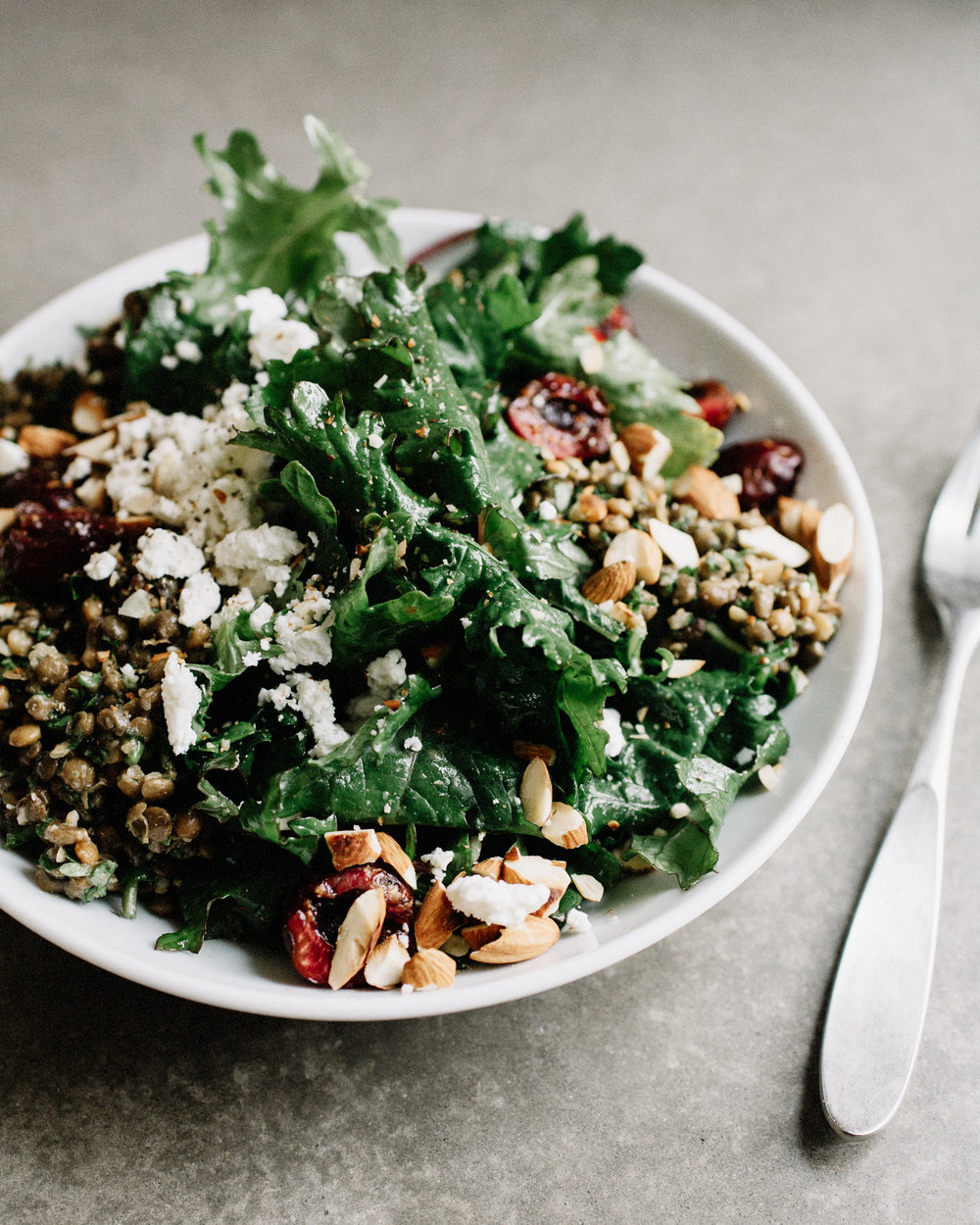 BABY KALE SALAD WITH CHERRIES, MARINATED LENTILS + GOAT CHEESE