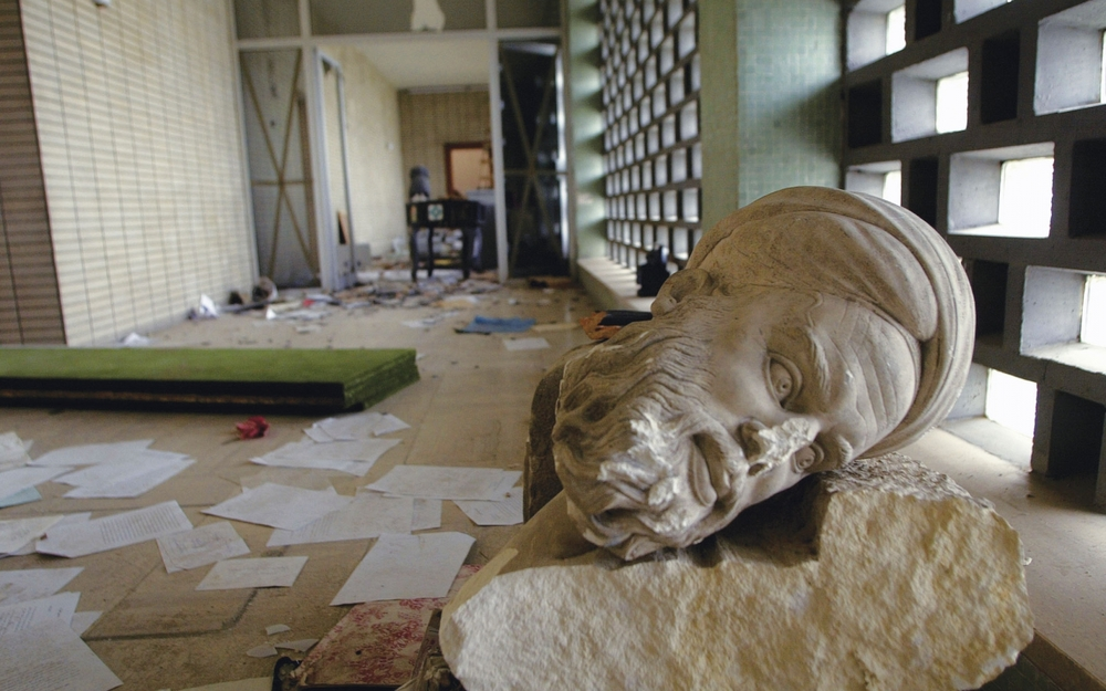 Image 3: Aftermath of 2003 looting at Iraq's National Museum of Antiquities. Photograph: Yannis Kontos/Polaris/Eyevine, via  New Statesman   .   Accessed at:    http://www.newstatesman.com/culture/2014/10/treasure-trails-how-museums-became-diplomatic-fixers