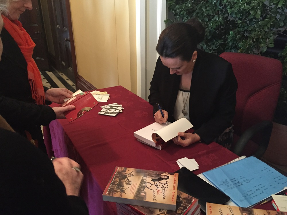 Jacqueline Dinan signs books at the Sydney launch of Between the Dances