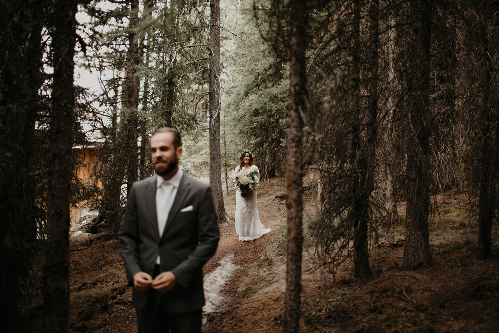 Moody, emotional first look in the forest | Banff Elopement Photographer Kandice Breinholt