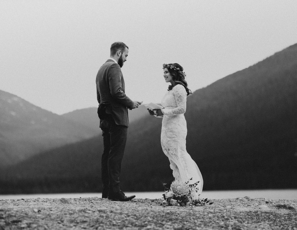 Sharing emotional vows during an elopement in Banff National Park, Canada - Banff Elopement Photographer Kandice Breinholt