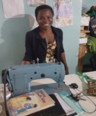 Bernadette teaching sewing