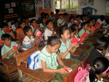 The local school with New Testament Bibles from the Gideons