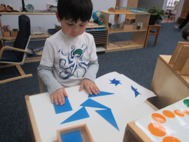 The Primary 1 students master their work and then work on extensions, which are fun variations of certain Sensorial materials such as the Triangle Construction Box.