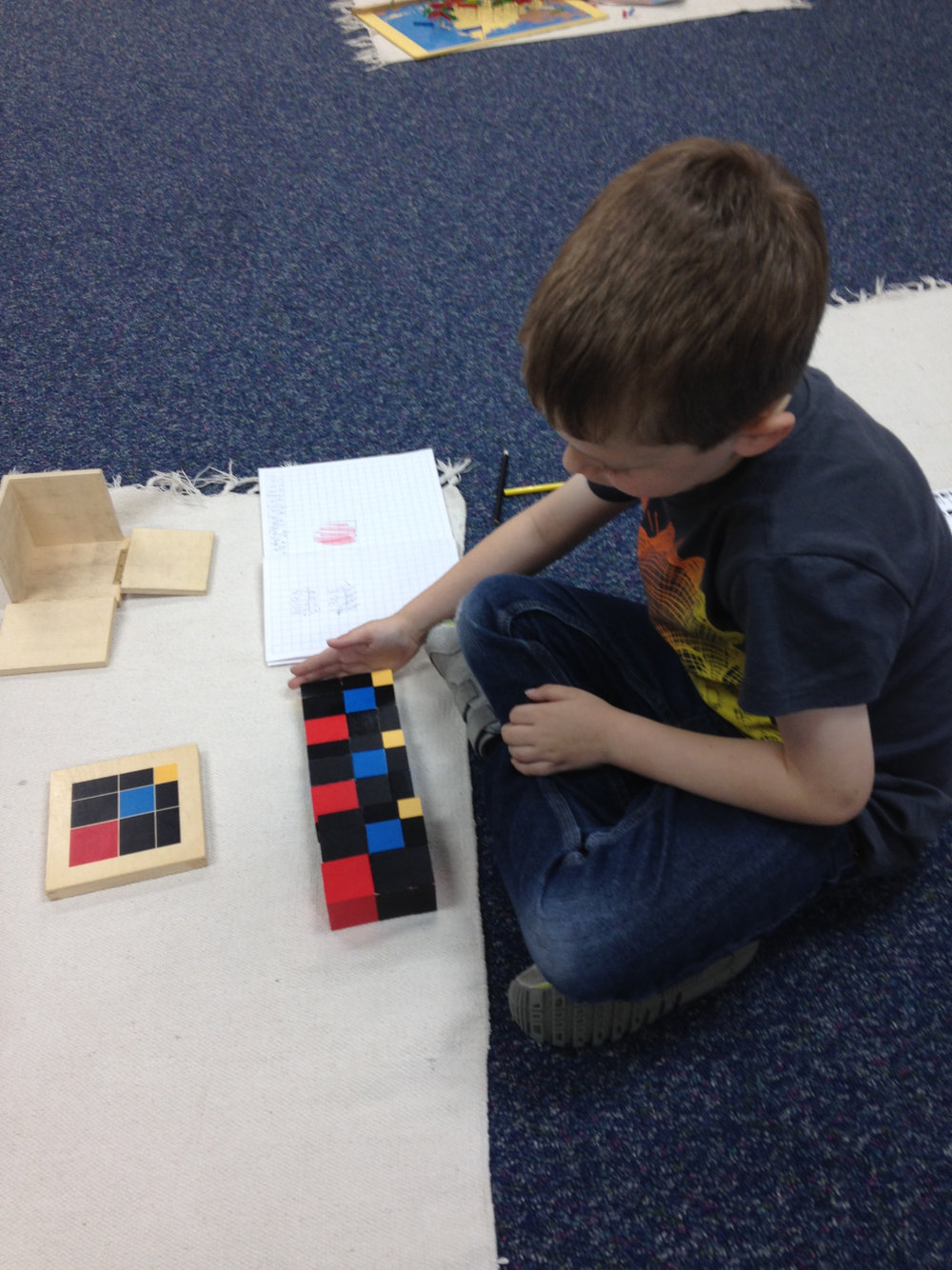 There are endless ways for students to explore the Trinomial Cube material, which is used in different ways at many levels in Montessori classrooms.  A Lower Elementary West student created a pattern independently.