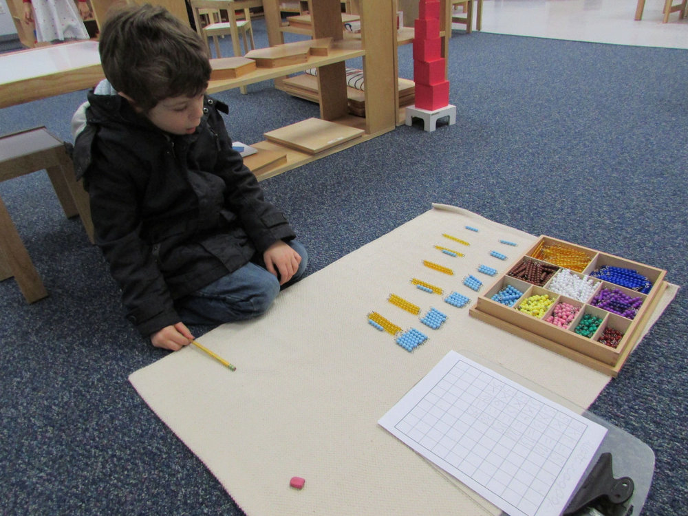 The beads in the Decanomial Box offer Primary 3 students a concrete way to practice multiplication facts.