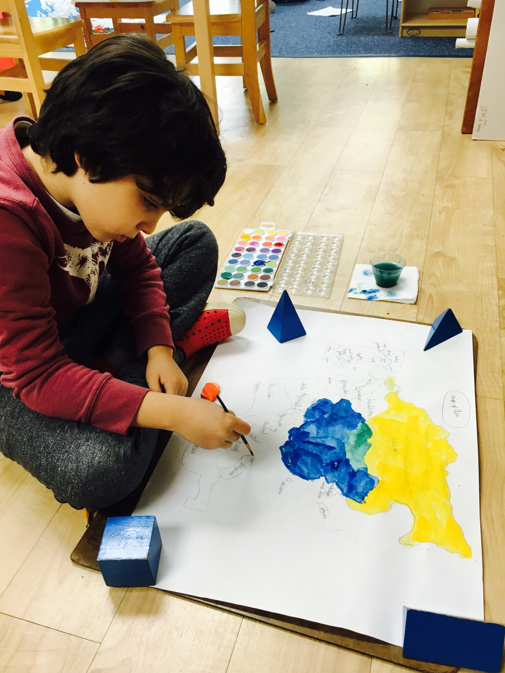 The Lower Elementary West students continued to conduct research about Asia and their related projects. One student made a wonderful watercolor painting of the entire continent.