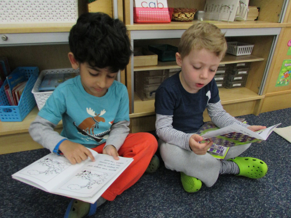 Many of the Primary 3 students enjoy sitting with a friend and looking at books, and they are encouraged to read to each other.