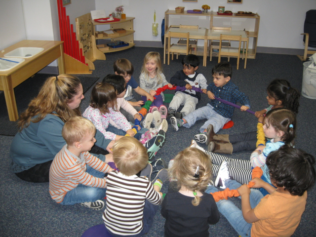 "The Toddler 2 students were delighted to welcome Ms. Cristina back to the classroom this week.  They were excited to sing their favorite songs, dance with scarves, play instruments, and ""clippity-clop"" on the rhythm rope."