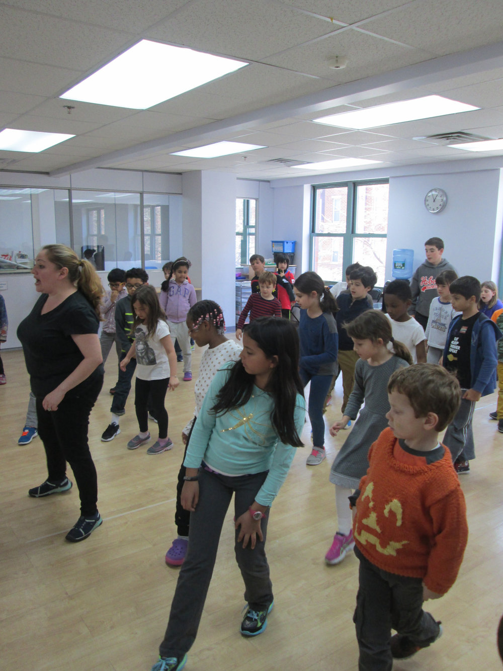 The Lower Elementary East Students were excited to be rehearsing for this year's musical production of  The Lion King !  In this captured moment, Ms. Cristina taught the students choreography for the song  Hakuna Matata .