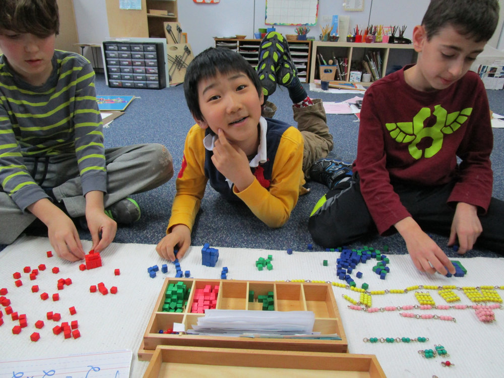 These Lower Elementary North students used the Bead Chains to learn about squaring and cubing.  They also wanted to build their own chains using other materials in the classroom.