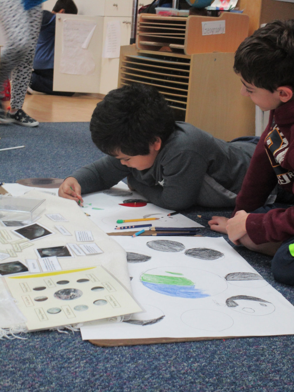 The Lower Elementary North class learned information about the moon.  Two students drew posters to show the phases of the moon.