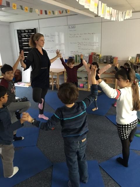 "During yoga class the first grade Lower Elementary West students enjoyed learning sun salutations, breathing exercises and many poses.  Yoga has many benefits for children, such as developing their focus, confidence and ability to just ""be""."