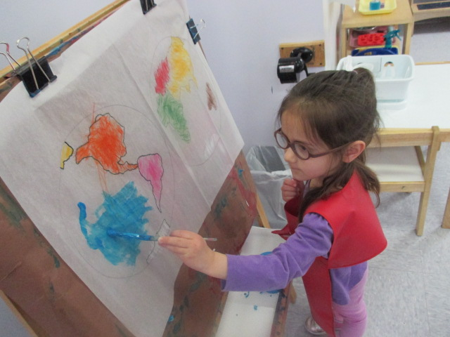 A young Primary 1 student was intently focused on tracing, then painting her very first continent map.