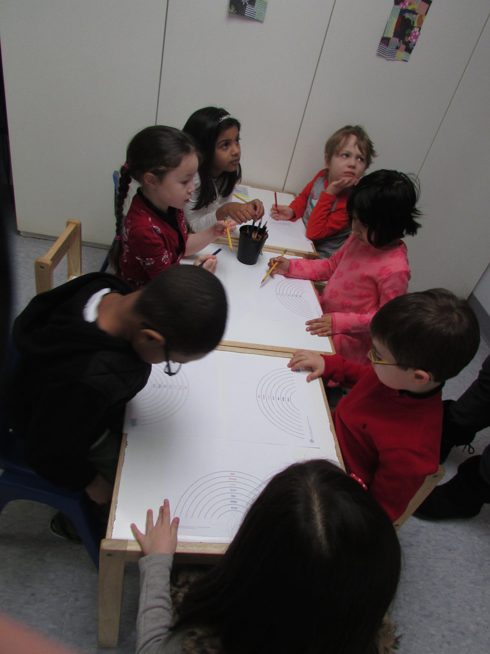 In this week's Kindergarten writing class, the students worked to creatively describe a given topic.  Some students described their magical sneakers, while others described a spooky house. They drew and decorated pictures and later, using sentence starters, wrote their own sentences describing their topics.