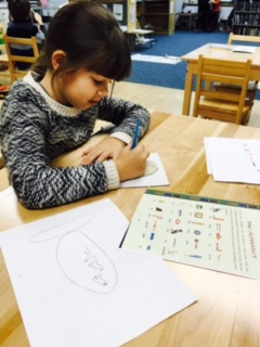"As their study of Africa comes to an end, the Lower Elementary West students are studying the ancient civilization of Egypt.  They explored hieroglyphs and had an opportunity to carve their names on a clay tablet or ""cartouche""."