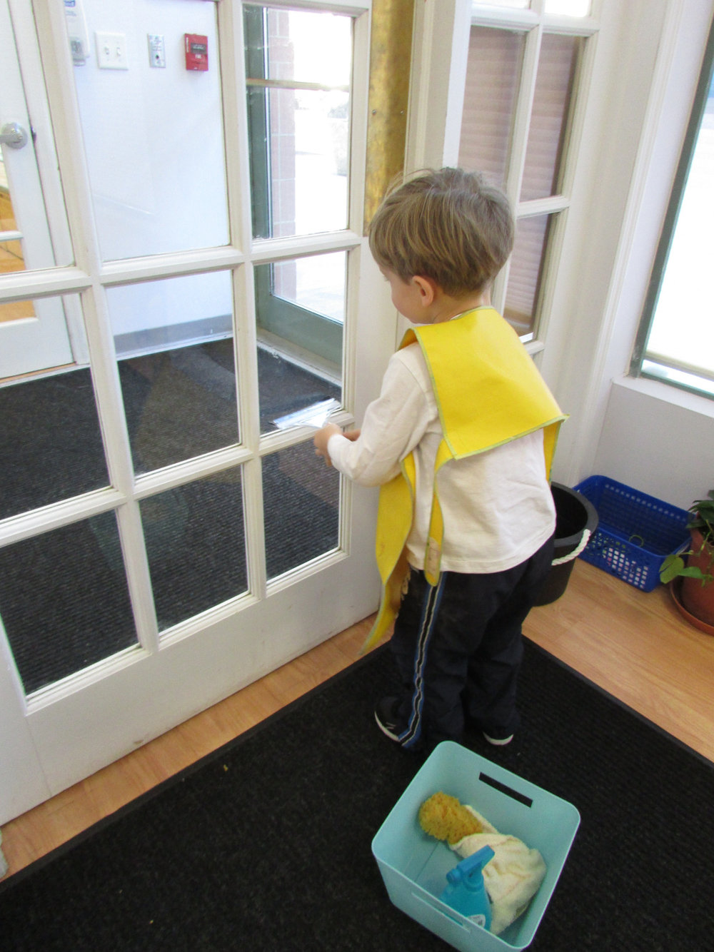 Window washing is a new and popular work in the Primary 3 classroom. The students enjoy following each sequential step as they spray and wipe the glass and help to keep their classroom clean. This work helps to develop their independence and concentration.