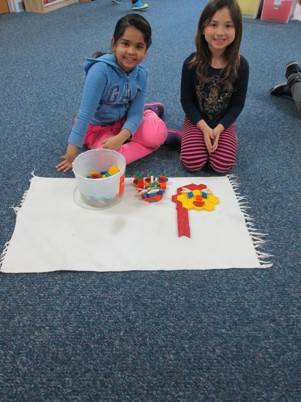 Once school resumed after Winter Storm Jonas, the Lower Elementary East students had a wonderful time during indoor recess on Tuesday.  Before going outside throughout the rest of the week, the students had the opportunity to use works from the Practical Life shelf.  One student chose to create a design using tangrams.