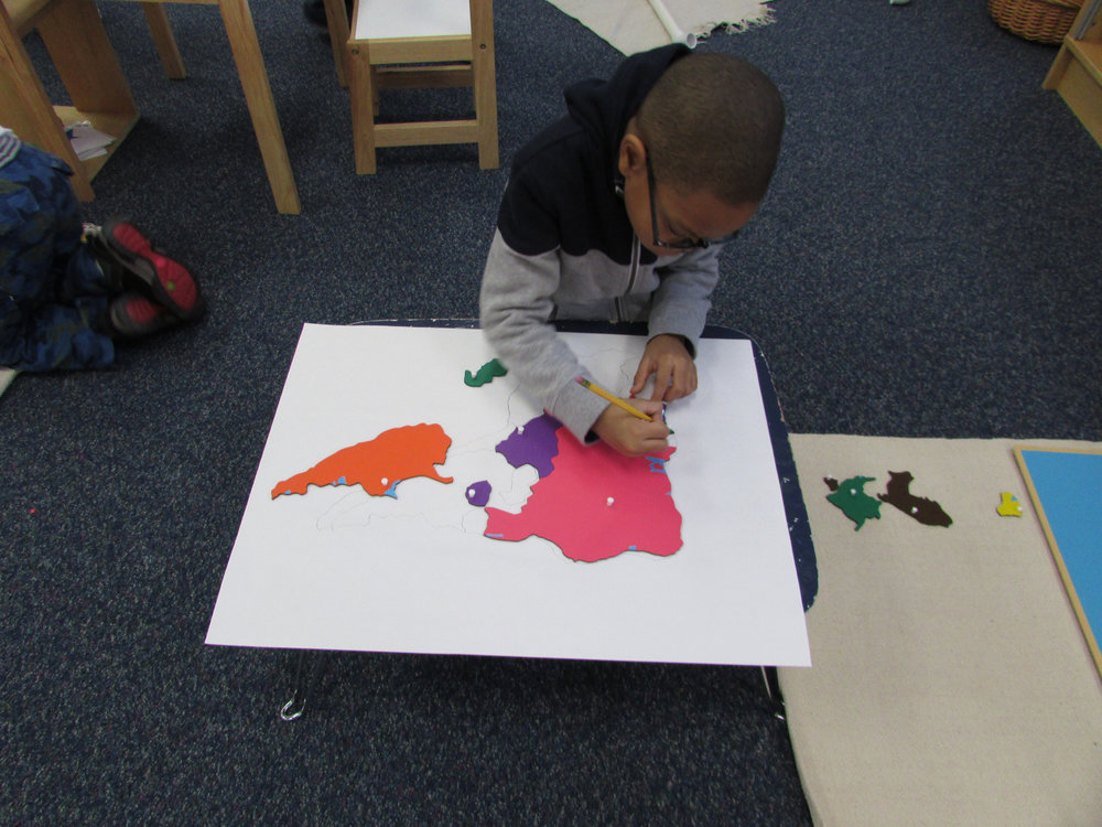 Map making is a popular work in the Primary 3 classroom.  The older students are encouraged to rebuild the map puzzle onto white paper and then trace each country before coloring it in.  This requires lots of concentration and helps to develop fine motor skills.