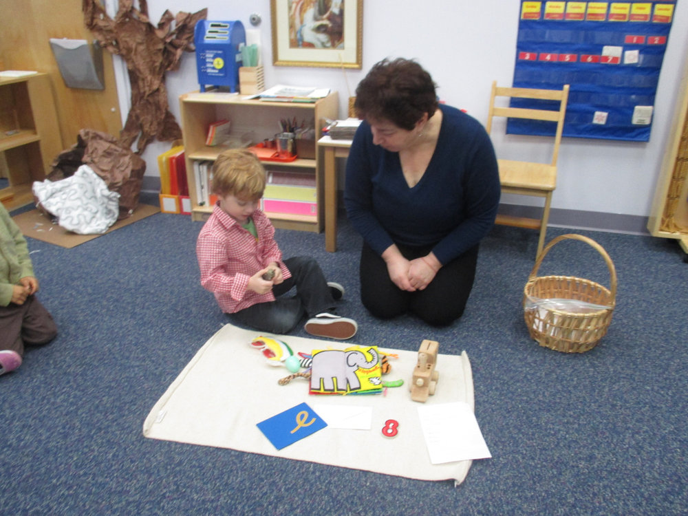 A three-year-old Primary 1 student had the opportunity to share his sound basket during circle time.  He collected and presented different things starting with the sound of the letter 'e'.