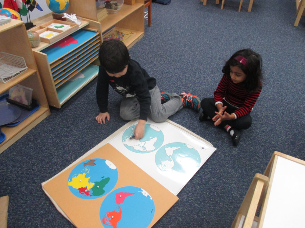 In the Primary 1 classroom, it is amazing to watch Kindergartners give lessons to their younger friends.  The younger students are inspired by their older friends, and the older students reinforce their own learning as they teach the lesson to another.  It is a perfect illustration of why there are mixed age groups in Montessori classrooms.