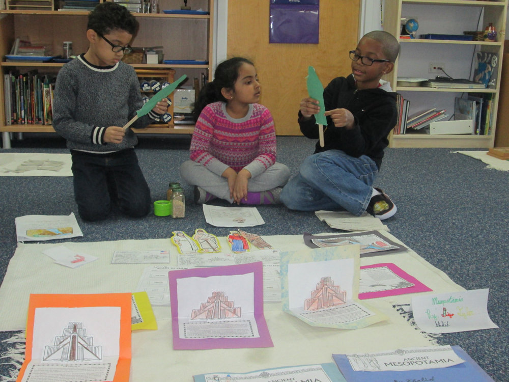 Since the beginning of December, the Lower Elementary East students have diligently worked on research about either Ancient Mesopotamia or Ancient China.  These extensive projects required the students to complete an array of academic activities such as reading, writing and creating crafts representative of their chosen civilization.  Additionally, due to the collaborative nature of these small group projects, the students enhanced their cooperative learning skills and presentation skills.