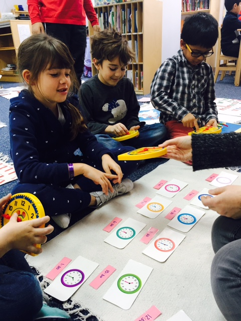 "The Lower Elementary West first grade students continued to work on time, learning ""half past""."