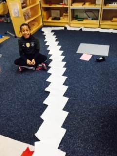 A Lower Elementary West student decided to challenge herself with a very long division problem that went from one side of the room almost to the other!