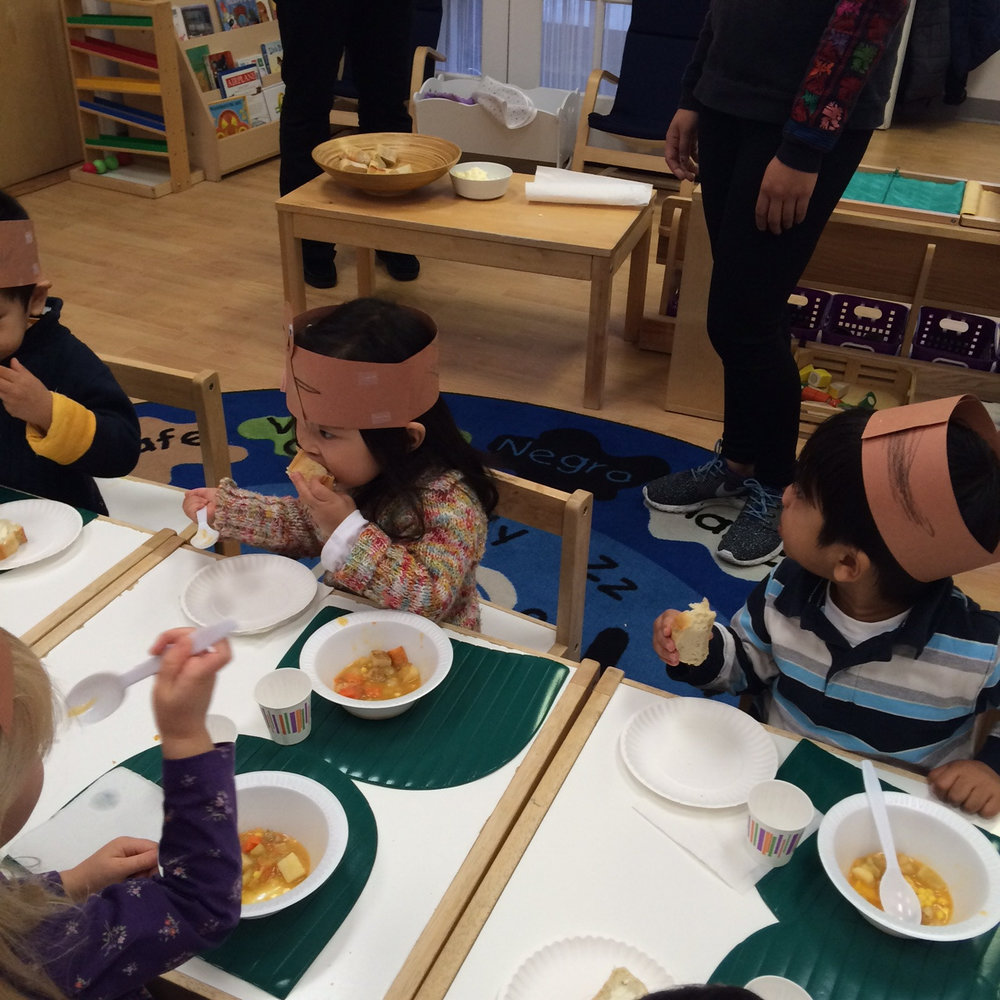 The Toddler 1 class prepared vegetables for their Thanksgiving soup one day and then feasted on soup, baguettes and homemade butter the next.