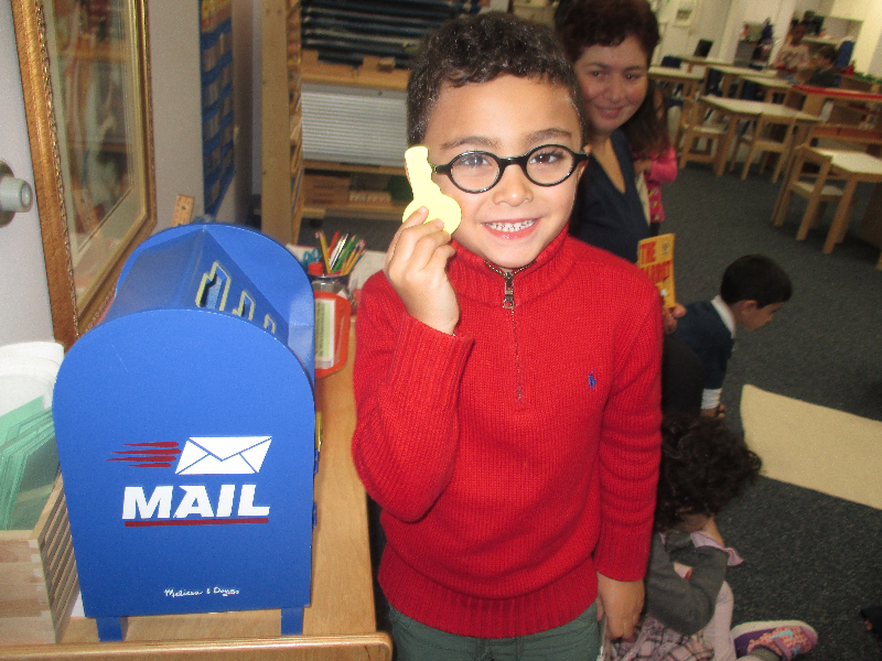 A Primary 1 student was excited to be the classroom mailman for holiday mail for his fellow schoolmates and teachers.