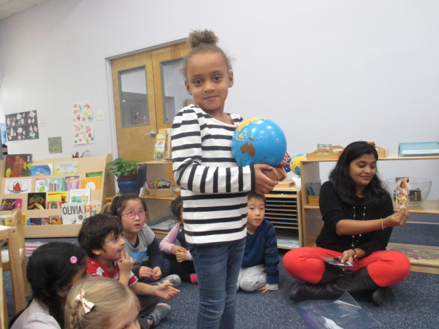 A Primary 1 student celebrated her fourth birthday in the traditional Montessori style.  She walked around the Sun four times with the globe in her hand to represent the number of years she has been alive. Classmates cheered for her and sang The Earth Goes Around the Sun.