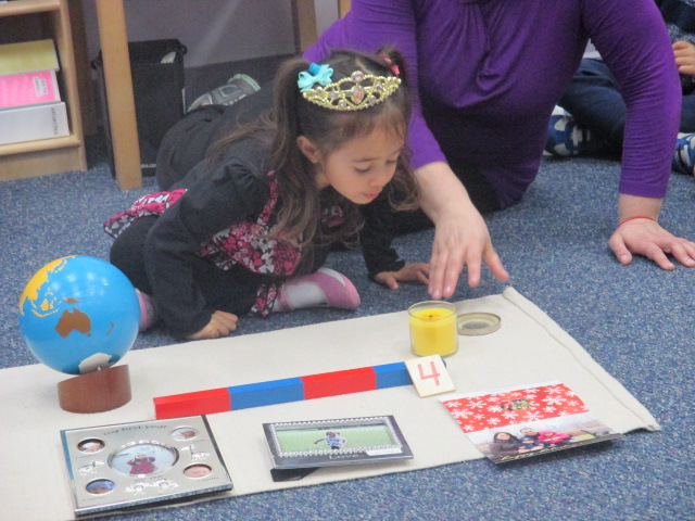 The Primary 1 class honored the fourth birthday of a classmate with the traditional Montessori birthday celebration.