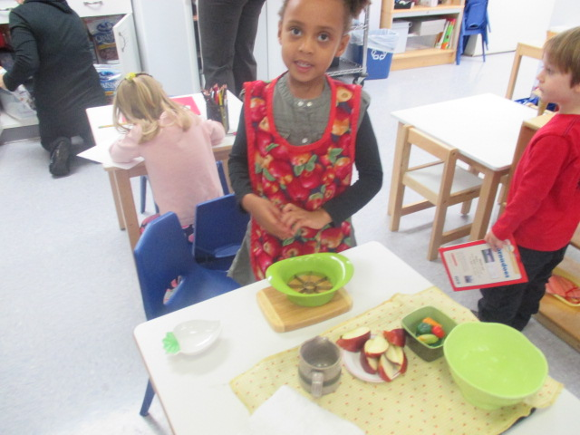 The Primary 1 students enjoyed learning how to cut an apple. They washed, cut and shared their apples with friends. Cutting an apple with an apple cutter requires a lot of muscular strength and adult supervision and enhances fine motor skills.